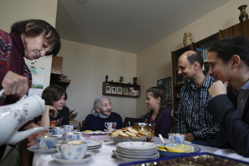 In this Sunday Nov. 11, 2012 photo from left:Luiza Rozina, 78, Daniil Rozin, 11, Geda Rozina, 100, Maya Rozina, 8, Mark Rozin, 47, Lev Rozin, 24, drink tea at their apartment in Moscow. The four generations of Zimanenko- Rozin's family embody the history of Jews in Russia over the past century, from the restrictions of czarist times to the revival of Jewish culture in Russia today. (AP Photo/Sergey Ponomarev)