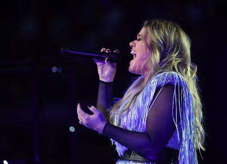 Aug 27, 2018; New York, NY, USA; Kelly Clarkson performs at the opening ceremony of the 2018 U.S. Open tennis tournament at USTA Billie Jean King National Tennis Center. Mandatory Credit: Robert Deutsch-USA TODAY Sports