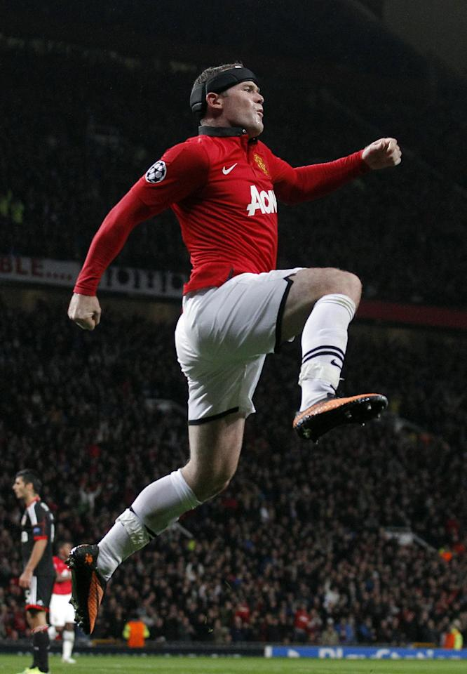 Manchester United's Wayne Rooney celebrates after he scored the third goal of the game for his side during their Champions League Group A soccer match at Old Trafford in Manchester, England, Tuesday Sept 17, 2013. (AP Photo/Jon Super)
