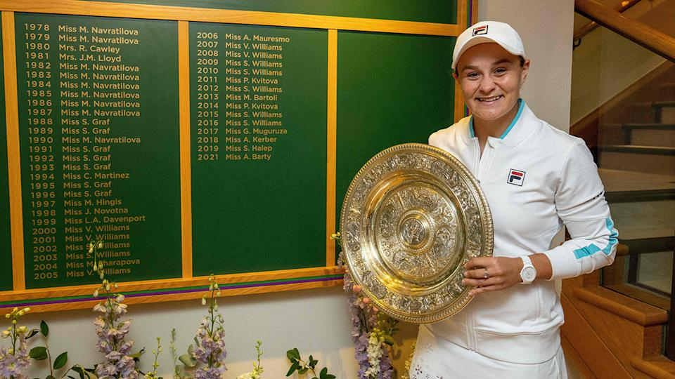 Ash Barty, pictured here in front of the Ladies' Singles Winner's Board after winning Wimbledon.