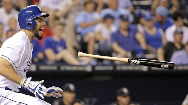 Kansas City Royals' Eric Hosmer tosses his bat before running to first as he grounds out during the sixth inning of a baseball game against the Chicago White Sox on Wednesday, May 21, 2014, in Kansas City, Mo. (AP Photo/Charlie Riedel)