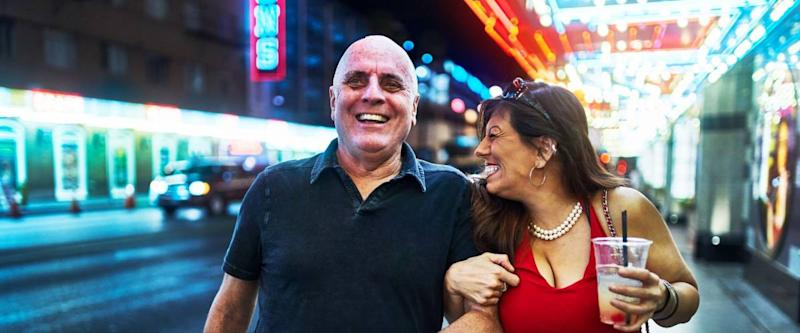 mature couple sightseeing in downtown las vegas streets