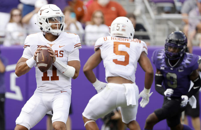 Texas quarterback Casey Thompson (11) looks to throw against TCU during the first half of an NCAA college football game Saturday, Oct. 2, 2021, in Fort Worth, Texas. (AP Photo/Ron Jenkins)