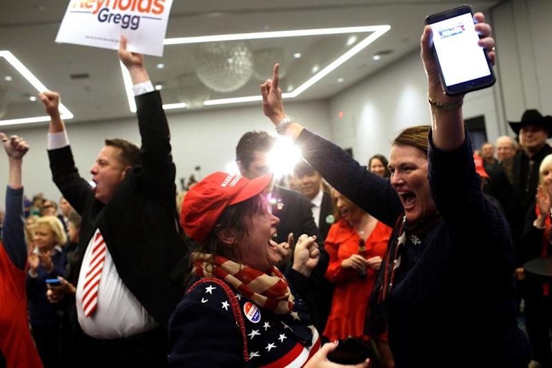 Republican supporters cheer after Iowa's Republican candidate for governor won re-election.