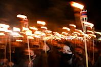 Armenians take part in a torchlight procession in Yerevan to mark the 106th anniversary of World War I-era mass killings