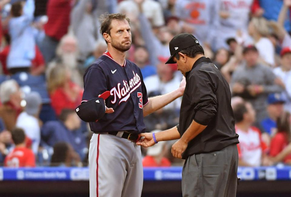 Max Scherzer has his belt checked after he pitched the first inning against the Phillies at Citizens Bank Park on Tuesday night.