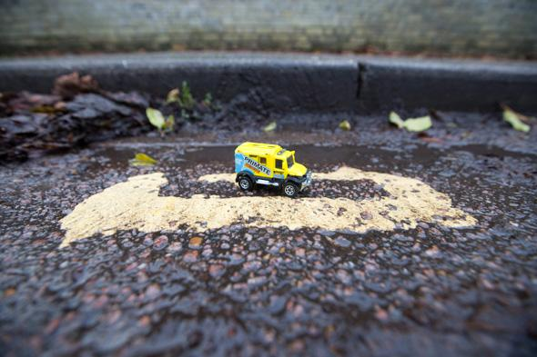 Mandatory Credit: Photo by Geoff Robinson Photography/REX (4313773b) A toy car parked on the 28cm long double yellow lines on Hamilton Road Council workers paint tiny double yellow lines measuring just 28cm, Cambridge, Britain - 18 Dec 2014 *Full story: http://www.rexfeatures.com/nanolink/prog Residents have been left bemused after council workers painted the SHORTEST double yellow lines in the UK measuring just 28cm. They were shocked when the set of yellow lines, which are shorter than a ruler, were painted between two parking zones in a street in Cambridge. Motorists will be fined either �50 or �70 if they manage to squeeze on the lines, which are the length of four toy cars. Locals have branded the new lines