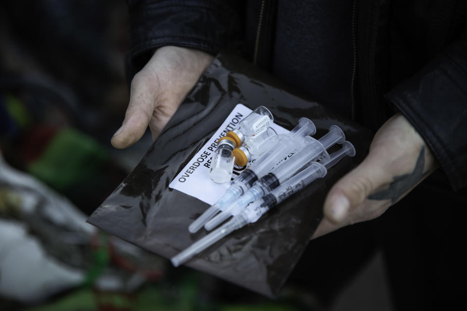 Narcan kits are available at a homeless encampment in Minneapolis, Minnesota on October 22, 2018. The growing homeless encampment near the Little Earth housing project in Minneapolis has caused concern to local health officials and native American leaders. - At the tent city for homeless people, the path is strewn with used syringes. Some are shooting up in the open. Dozens have been found unconscious. At least two have died. Most of the more than 200 people here are Native Americans, who have spontaneously gathered over the past few months in this otherwise economically prosperous city. The existence of the camp against a backdrop of gleaming skyscrapers is shining a light on a homelessness crisis sparked by a lack of affordable housing, mental health care and drug addiction treatment. Native Americans are disproportionately affected in all cases. (Photo by Kerem Yucel / AFP)        (Photo credit should read KEREM YUCEL/AFP via Getty Images)