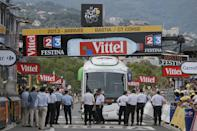French gendarmes stand next to the Orica Greenedge cycling team bus after it got stuck on the finish line of the first stage of the Tour de France cycling race over 213 kilometers (133 miles) with start in Porto Vecchio and finish in Bastia, Corsica island, France, Saturday June 29, 2013. (AP Photo/Laurent Rebours)