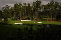 Jimmy Walker and C.T. Pan, of Taipei, walk to the 16th green with their caddies during a practice round for the Masters golf tournament Tuesday, Nov. 10, 2020, in Augusta, Ga. (AP Photo/Matt Slocum)