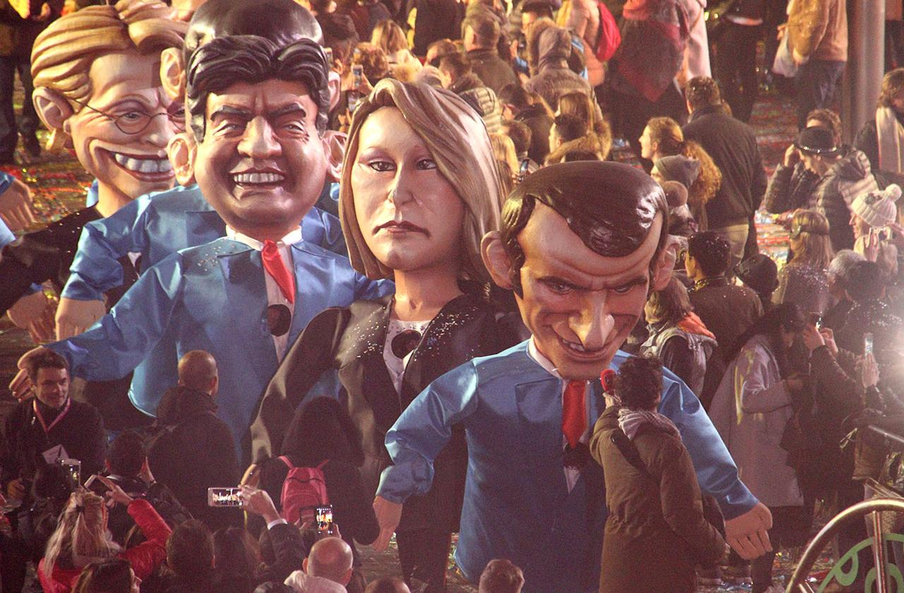 <p>Big heads showing left to right, French presidential election candidate for Leftist Front Jean-Luc Melanchon, far right regional leader for southeastern France, Marion Marechal-Le Pen and Presidential candidate Emmanuel Macron, parade during 133th Nice carnival parade, Saturday, Feb. 11, 2017, in Nice, southeastern France. (Photo: Henri Grivot/AP) </p>