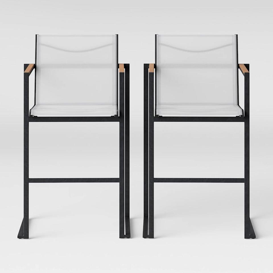 <p>Make sure there's always a seat at the bar with the <span>Henning Two-Pack Bar Height Patio Chair</span> ($250).</p>