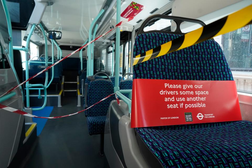 A cordon surrounds the front of a London bus on April 20, 2020 in London during the novel coronavirus Covid-19 pandemic. - London's transport authorities have put in place new measures to protect bus drivers from coronavirus. (Photo by Niklas HALLE'N / AFP) (Photo by NIKLAS HALLE'N/AFP via Getty Images)