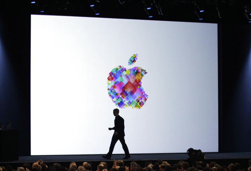 FILE-In this Monday, June 11, 2012, file photo, Apple CEO Tim Cook walks on stage during the Apple Developers Conference in San Francisco. Makers of consumer electronics are refreshing their products for the holiday shopping season. Apple's rivals are hoping that a head start on the buzz will translate into stronger sales. Nokia and Microsoft, in particular, are trying to generate interest in a new Windows operating system out next month.  (AP Photo/Marcio Jose Sanchez, File)