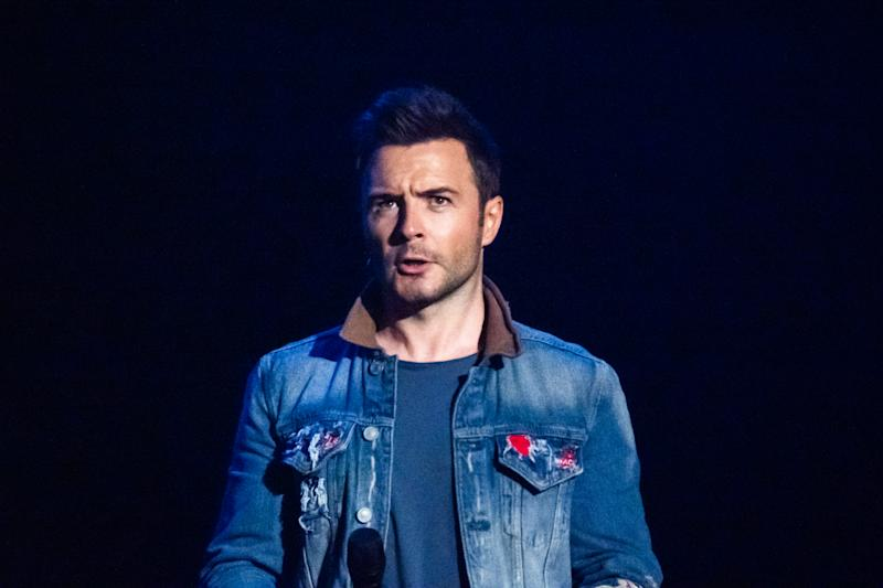 BEIJING, CHINA - AUGUST 13: Irish singer/songwriter Shane Filan of Irish pop vocal group Westlife performs during their concert 'The Twenty Tour' at Cadillac Arena on August 13, 2019 in Beijing, China. (Photo by Visual China Group via Getty Images/Visual China Group via Getty Images)