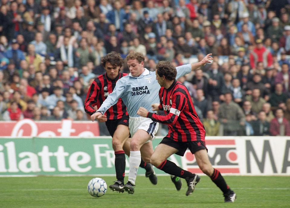 Lazio's Paul Gascoigne of England dribbles between Milan's Paolo Maldini, left, and Franco Baresi during a First Division soccer match in Rome, Italy, on Feb 20, 1994, Milan beat Lazio 1 goal to nil. (AP Photo/Bruno Mosconi)