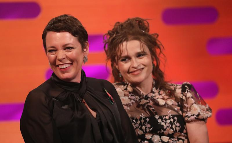 Olivia Colman (left) and Helena Bonham Carter during the filming for the Graham Norton Show at BBC Studioworks 6 Television Centre, Wood Lane, London, to be aired on BBC One on Friday evening. (Photo by Isabel Infantes/PA Images via Getty Images)