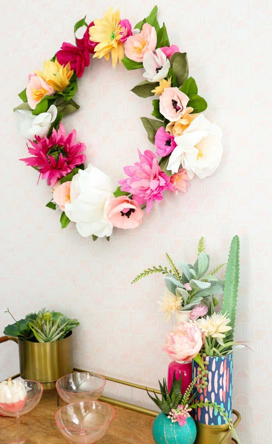 """<p>It's funny how much paper flowers can look just like the real deal, particularly when you use crêpe paper to craft them. This flowery wreath is just the thing to complete your Easter décor. </p><p><strong>Get the tutorial at <a href=""""https://abeautifulmess.com/how-to-make-a-paper-flower-wreath/"""" rel=""""nofollow noopener"""" target=""""_blank"""" data-ylk=""""slk:A Beautiful Mess"""" class=""""link rapid-noclick-resp"""">A Beautiful Mess</a>.</strong></p><p><a class=""""link rapid-noclick-resp"""" href=""""https://go.redirectingat.com?id=74968X1596630&url=https%3A%2F%2Fwww.walmart.com%2Fip%2FForest-Green-Premium-Crepe-Paper-19-X-250cm-by-Paper-Mart%2F277756745&sref=https%3A%2F%2Fwww.thepioneerwoman.com%2Fhome-lifestyle%2Fcrafts-diy%2Fg35698457%2Fdiy-easter-wreath-ideas%2F"""" rel=""""nofollow noopener"""" target=""""_blank"""" data-ylk=""""slk:SHOP CREPE PAPER"""">SHOP CREPE PAPER</a></p>"""