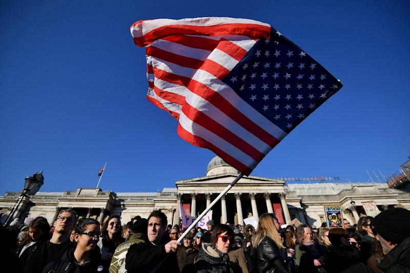 A protester waves the US flag during the 'Women's March' in Trafalgar Square in London on January 21, 2017 as he joins thousands of others as part of a global day of protests against new US President Donald Trump (AFP Photo/BEN STANSALL)