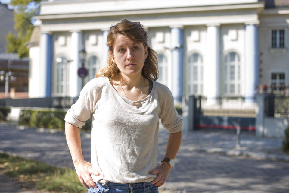 Naomi Henkel-Guembel poses for a portrait in front of the synagogue at the Fraenkelufer in Berlin, Germany, Wednesday, Sept. 23, 2020. Naomi Henkel-Guembel survived the anti-Semitic attack on the synagogue in the city of Halle in central Germany Yom Kippur in 2019. (AP Photo/Markus Schreiber)