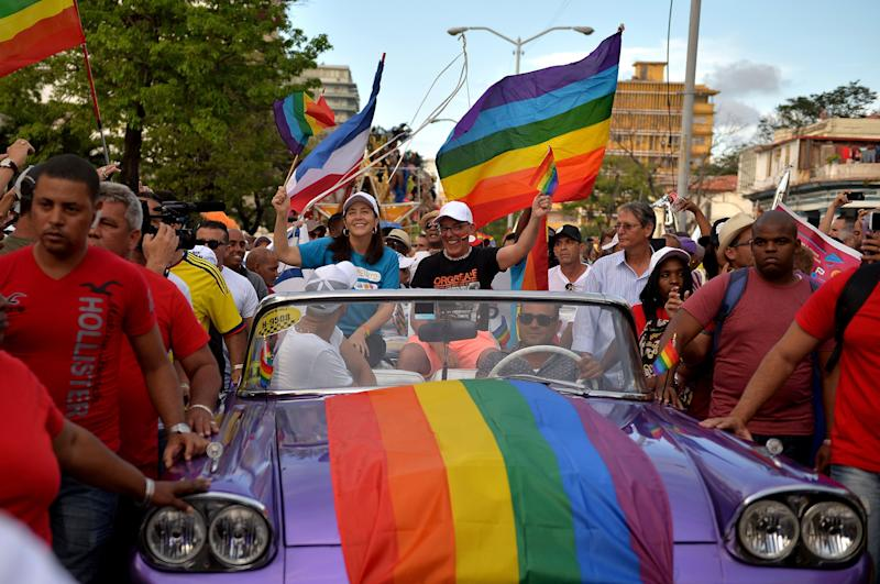 Mariela Castro, center, daughter of Cuban former President Raul Castro and the director of the National Center for Sex Education (CENESEX), participates in the Gay Pride parade during the celebration of the day against homophobia and transphobia in Havana.
