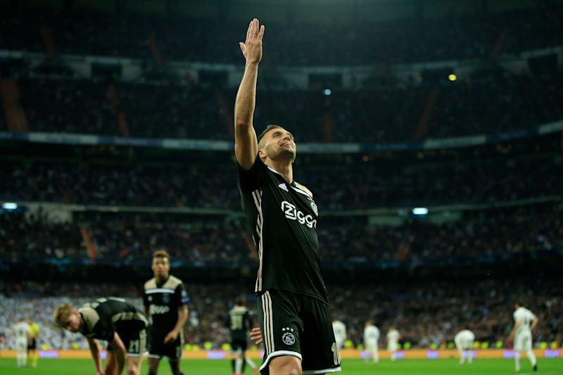 Ajax's Dusan Tadic celebrates after scoring his side's third goal during the Champions League round of 16 second leg soccer match between Real Madrid and Ajax at the Santiago Bernabeu stadium in Madrid, Tuesday, March 5, 2019. (AP Photo/Bernat Armangue)