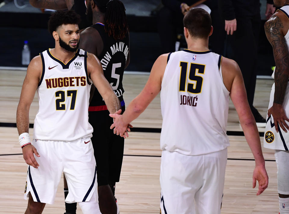 Nuggets stars Jamal Murray and Nikola Jokic thoroughly outplayed the Clippers in Game 7. (Douglas P. DeFelice/Getty Images)