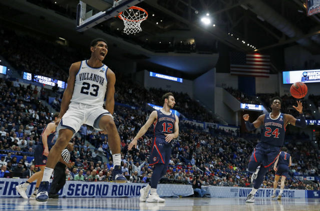 Villanova's Jermaine Samuels (23) screams after his dunk against St. Mary's Tommy Kuhse (12) and Malik Fitts (24) during the second half of a first round men's college basketball game in the NCAA Tournament, Thursday, March 21, 2019, in Hartford, Conn. (AP Photo/Elise Amendola)