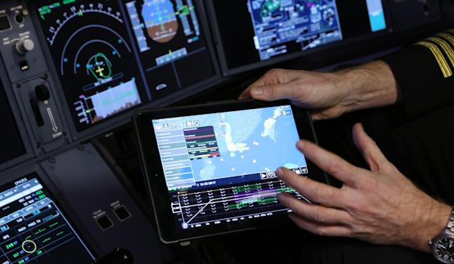 The new digital flight and weather application will help Cathay Pacific to save 1 million litres of fuel a year. Photo: K.Y. Cheng