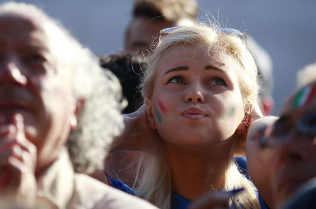 An Italian soccer fan snorts as she watches on a giant screen a World Cup soccer match between Italy and Costa Rica, in Rome, Friday, June 20, 2014. Costa Rica won 1-0. (AP Photo/Gregorio Borgia)