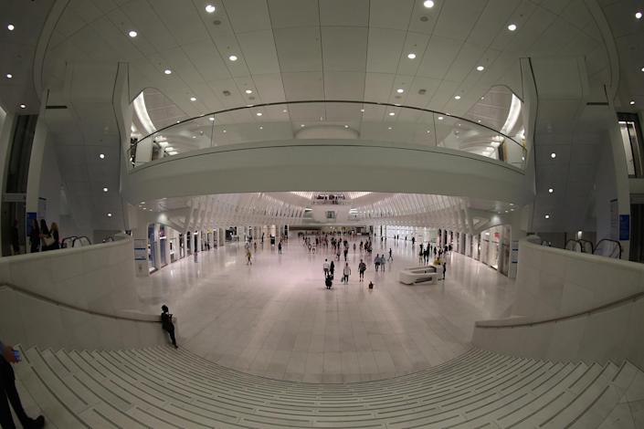 <p>People walk through the Oculus mall at World Trade Center on Wednesday, August 17, 2016. More than 300,000 commuters use it on a daily basis, many for jobs beyond finance in advertising and media. (Gordon Donovan/Yahoo News) </p>