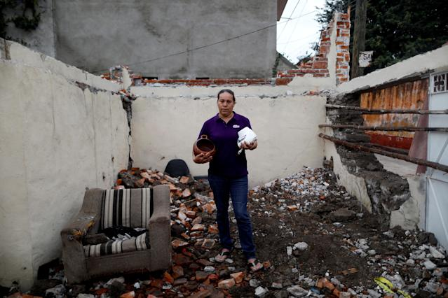 "<p>Maria Trinidad Gonzalez, 41, a housewife, holds some cookware as she poses for a portrait on the rubble of her house after an earthquake in Tepalcingo, Mexico, September 29, 2017. The house was badly damaged, but with the help of her family and soldiers Gonzalez rescued some furniture. She lives in her backyard and hopes to return home once it's rebuilt. ""The most valuable thing that I recovered was my cookware,"" Gonzalez said. (Photo: Edgard Garrido/Reuters) </p>"