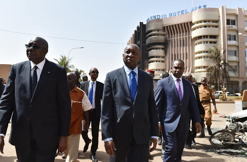 Malian Prime Minister Modibo Keita (L), Burkina Faso's Prime Minister Paul Kaba Thieba (C) and Foreign Minister Alpha Barry leave after visiting the Splendid Hotel in Ouagadougou on January 17, 2016, following a jihadist attack (AFP Photo/Issouf Sanogo)