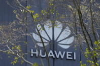 The Huawei brand logo is seen on a building in the sprawling Huawei headquarters campus in Shenzhen, China, Saturday, Sept. 25, 2021. Two Canadians detained in China on spying charges were released from prison and flown out of the country on Friday, Prime Minister Justin Trudeau said, just after a top executive of Chinese communications giant Huawei Technologies reached a deal with the U.S. Justice Department over fraud charges and flew to China. (AP Photo/Ng Han Guan)