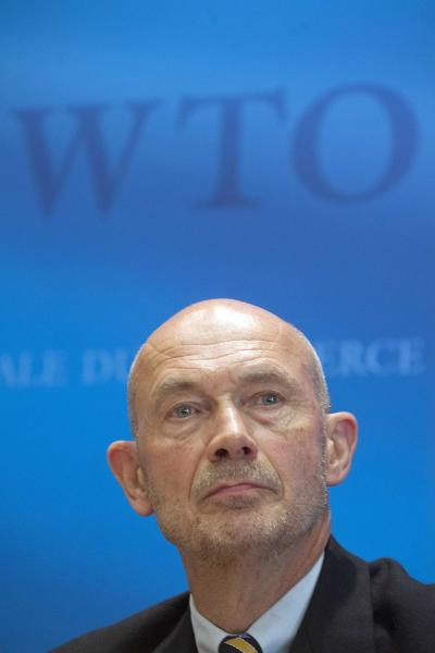 Director General of the World Trade Organization, WTO, Pascal Lamy addresses a news conference on annual trade forecast and statistics at the WTO headquarters in Geneva, Thursday, April 12, 2012. Europe's sovereign debt crisis and other economic shocks are expected to slow the growth in global exports to just 3.7 percent in 2012, the WTO said. That comes after slowing to 5 percent in 2011, and would mark a sharp deceleration from the 13.8 percent growth rate in 2010. The figures represent the total volume of merchandise exported across borders, accounting for changes in prices and exchange rates. (AP Photo/Keystone, Sandro Campardo)