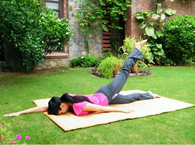 <b>Ardh Shalabh</b> (left leg): Lie on your stomach. Extend the right arm forward and the left one backwards. Lift the left leg (as much as you comfortably can), hold for seven counts and bring it down.