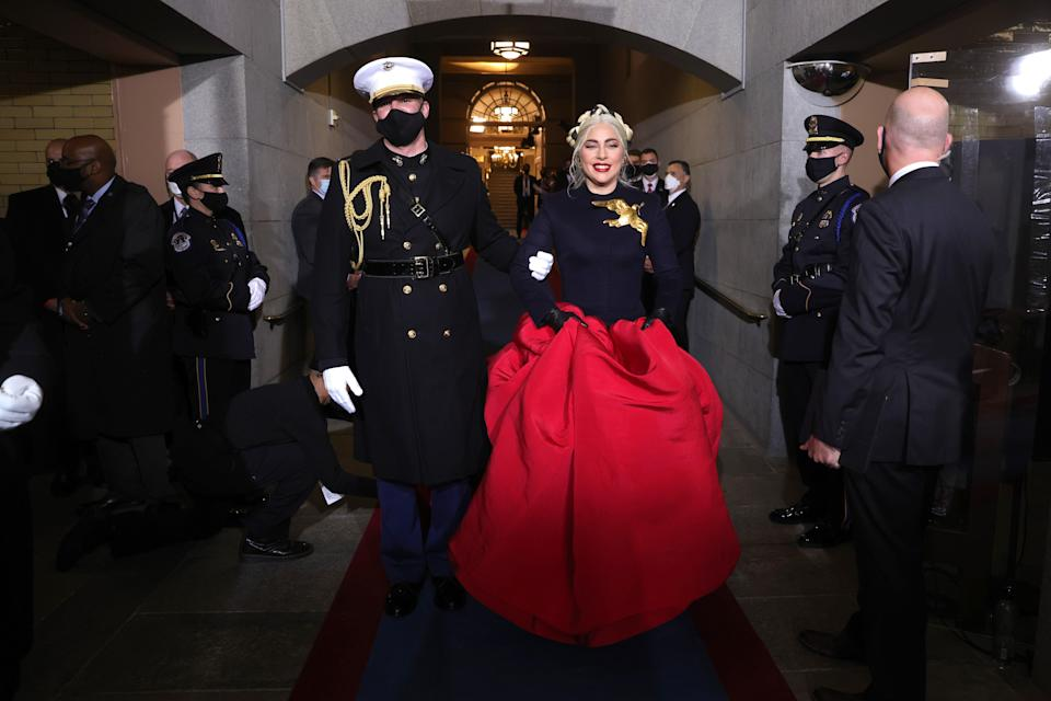 """Straight out of <em>The</em> <em>Hunger Games</em>, Lady Gaga wore Schiaparelli Haute Couture at the Inauguration and <a href=""""https://www.teenvogue.com/story/2021-inauguration-memes-bernie-sanders-lady-gaga-and-more?mbid=synd_yahoo_rss"""" rel=""""nofollow noopener"""" target=""""_blank"""" data-ylk=""""slk:served as inspiration for memes galore"""" class=""""link rapid-noclick-resp"""">served as inspiration for memes galore</a>."""