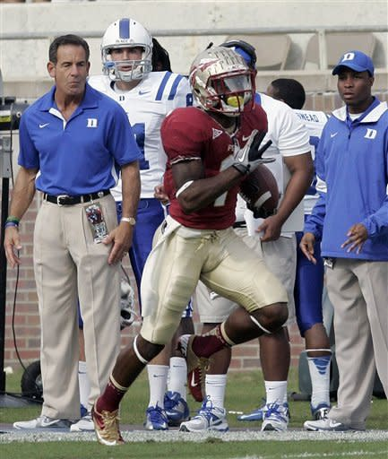 Duke's bench watches Florida State's Kelvin Benjamn run back a punt for a touchdown in the first quarter of an NCAA college football game on Saturday, Oct. 27, 2012, in Tallahassee, Fla. Florida State won the game 48-7. (AP Photo/Steve Cannon)