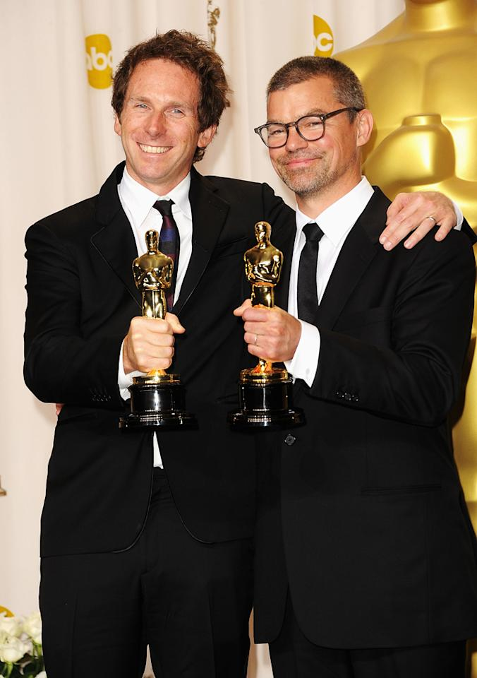 Kirk Baxter (L) and Angus Wall (R), winners for Best Film Editing for 'The Girl with the Dragon Tattoo,' pose in the press room at the 84th Annual Academy Awards held at the Hollywood & Highland Center on February 26, 2012 in Hollywood, California.