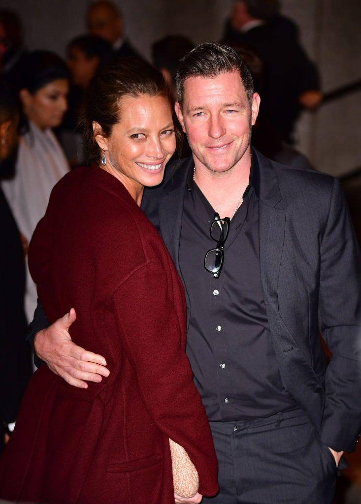 <p>The stylish couple posed for photos outside of the wedding reception.</p>