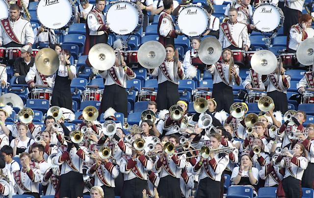 Massachusetts marching band ploys after a touchdown during the second half of an NCAA football game against Northern Illinois in Foxborough, Mass., Saturday, Nov. 2, 2013. Northern Illinois defeated Massachusetts, 63-19. (AP Photo/Stew Milne)