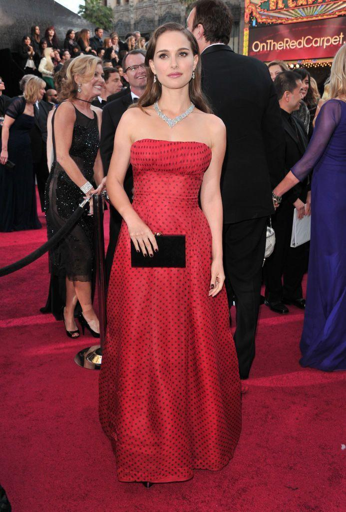 <p>The Black Swan star wore a red and black polka-dot gown by Christian Dior from 1954 to the Oscars. </p>