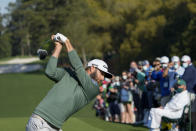 Dustin Johnson hits his tee shot on the first hole during a practice round for the Masters golf tournament on Monday, April 5, 2021, in Augusta, Ga. (AP Photo/David J. Phillip)