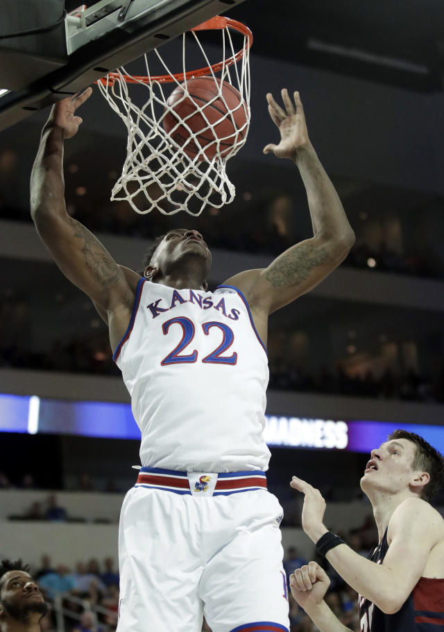 Kansas forward Silvio De Sousa (22) dunks over Pennsylvania forward AJ Brodeur, right, during the first half of an NCAA college basketball tournament first-round game, Thursday, March 15, 2018, in Wichita, Kan. (AP Photo/Orlin Wagner)