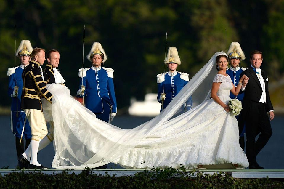 "<p>Princess Madeleine chose a flowing <a href=""http://www.vogue.co.uk/gallery/princess-madeleine-of-sweden-wedding-dress-valentino-bridal-gown"" rel=""nofollow noopener"" target=""_blank"" data-ylk=""slk:Valentino Garavani bespoke"" class=""link rapid-noclick-resp"">Valentino Garavani bespoke</a> dress, which featured short sleeves and yards of ruffled Chantilly lace.</p>"