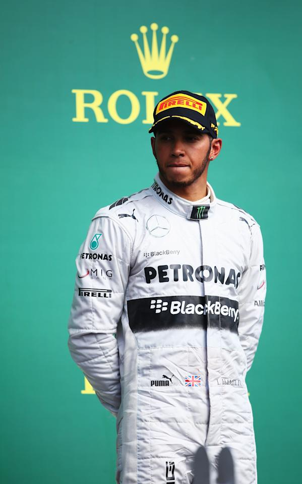 MONTREAL, QC - JUNE 09: Third placed Lewis Hamilton of Great Britain and Mercedes GP reacts on the podium following the Canadian Formula One Grand Prix at the Circuit Gilles Villeneuve on June 9, 2013 in Montreal, Canada. (Photo by Paul Gilham/Getty Images)