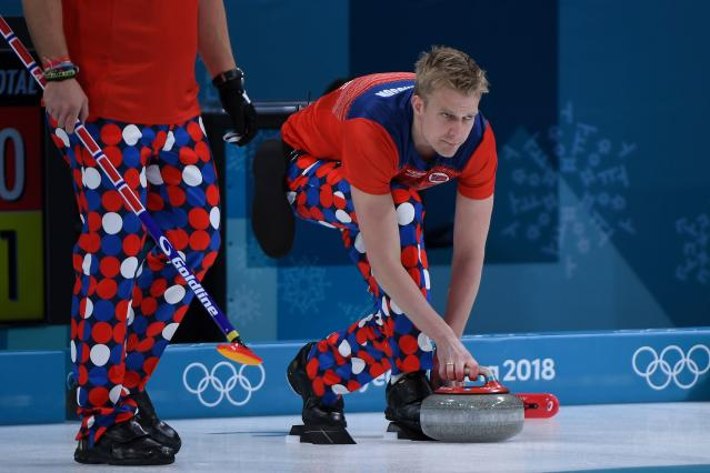 <p>Norway's Haavard Vad Petersson throws the stone during the curling men's round robin session between Norway and South Korea during the Pyeongchang 2018 Winter Olympic Games at the Gangneung Curling Centre in Gangneung on February 16, 2018. / AFP PHOTO / WANG Zhao (Photo credit should read WANG ZHAO/AFP/Getty Images) </p>