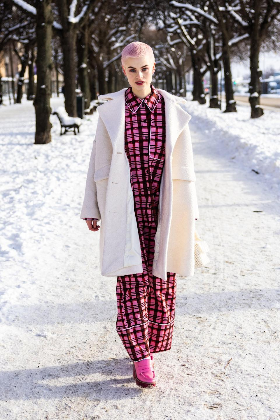 <p>Layer a snow-white wool coat over printed pajamas and style with loafers, and you'll look chic as can be.</p>