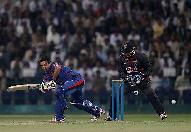 ABU DHABI, UNITED ARAB EMIRATES - JANUARY 16: Asghar Stanikzai of Afghanistan bats during the Desert T20 Challenge match between Afghanistan and UAE at Sheikh Zayed Stadium on January 16, 2017 in Abu Dhabi, United Arab Emirates. (Photo by Francois Nel/Getty Images)