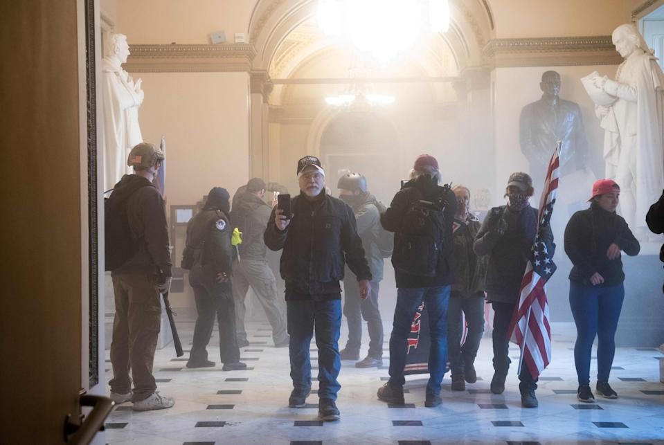 Pro-Trump rioters protest inside the US Capitol on Jan. 6, 2021, in Washington, DC. - Demonstrators breeched security and entered the Capitol as Congress debated the a 2020 presidential election Electoral Vote Certification.